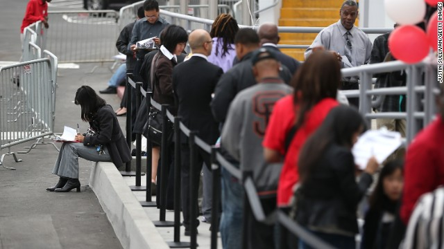 People waiting on line at a job fair.