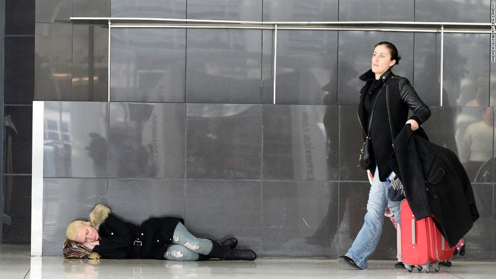 A woman sleeps on the floor of New York's JFK Airport on January 3.