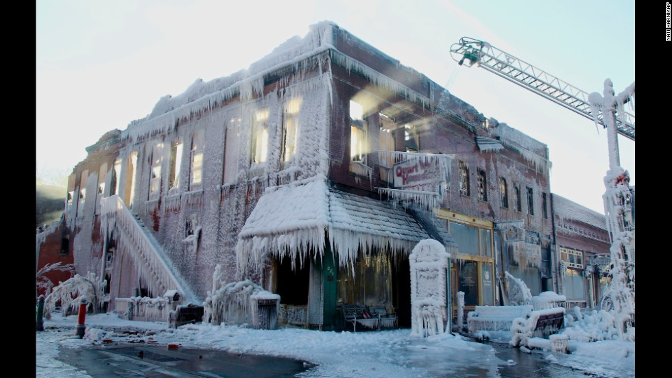 Sunlight beams through the windows of a building that caught on fire Friday, January 3, in Plattsmouth, Nebraska. The firefighters' water froze all over the building.