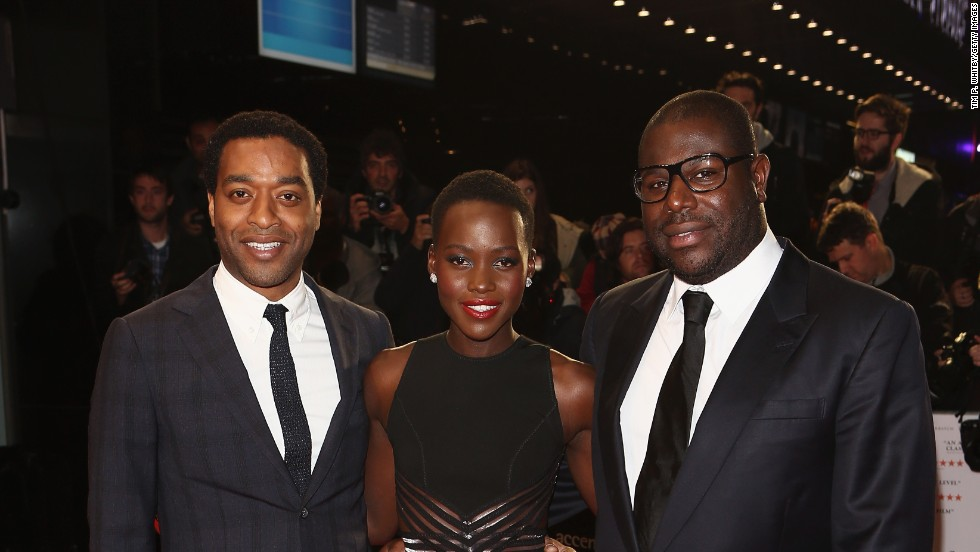 "Nyong'o pictured with ""12 Years"" star Chiwetel Ejiofor (left) and director Steve McQueen (right) at the movie's European premiere, at the London Film Festival on October 18, 2013."