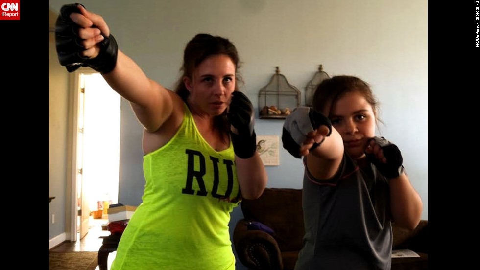 "Jenni Conner of Santa Maria, California, and her 9-year-old daughter, Skylar, do a combat fitness program together at home every night. ""I don't have to ask, she wants to do it,"" said Conner, a mom of two. ""She has lost weight and built muscle. ... It's all because she watched her mom and chose to follow my lead."""