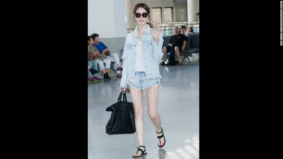 South Korean actress Lee Da-hae sported a trendy ensemble of ripped, bleached, cut off and acid-washed denim in August 2013, but don't expect to see anybody wearing this style next summer. Collections for 2014 are showing raw, pristine denim in a medium-tone blue.