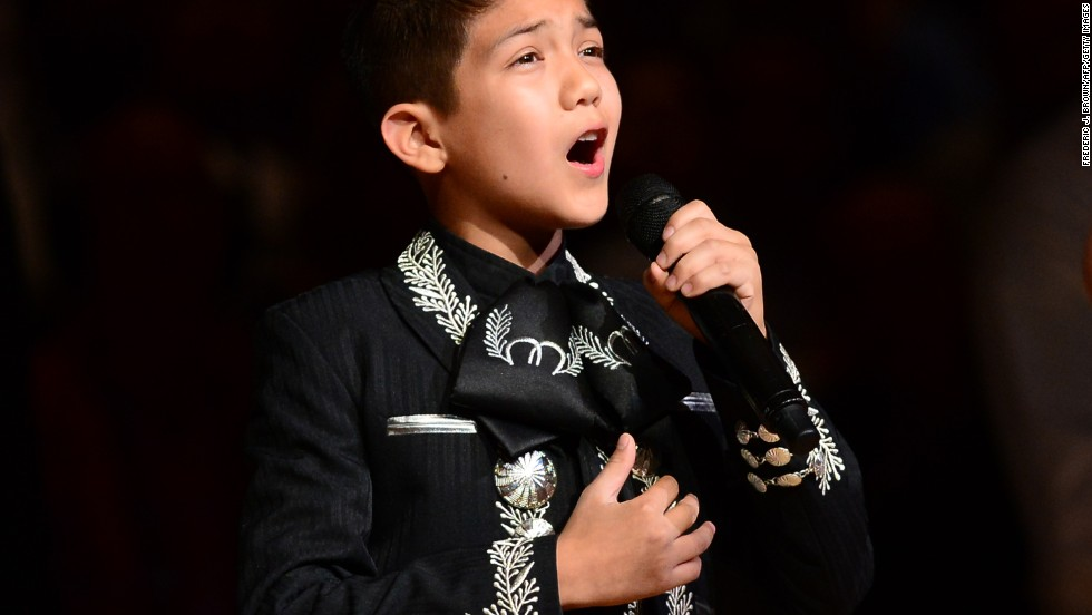 "Sebastien De La Cruz, known as San Antonio's Little Mariachi, sang the national anthem before an NBA finals game between the San Antonio Spurs and the Miami Heat in 2013. When <a href=""http://www.cnn.com/2013/06/12/us/mexican-american-boy-sings-anthem/"">some questioned his citizenship</a> and mariachi outfit, it sparked defense of the young singer from notables such as actress <a href=""http://www.cnn.com/2013/06/14/us/mexican-american-boy-encore/"">Eva Longoria</a>."