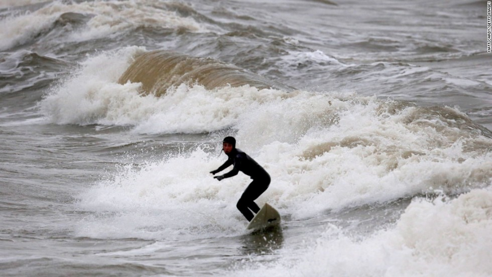These waves may be tiddlers for the professional surfers but rough seas off Porthcawl in Wales still attract a local pleasure seeker.