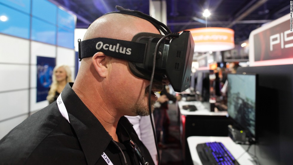 An attendee uses the Oculus Rift virtual-reality headset to view a game on the Piston Xi3 entertainment console.  The Piston sells for $1,000 and is available now.