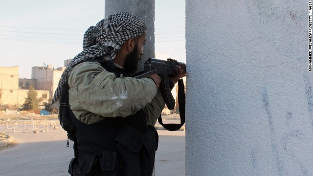 An opposition fighter guards a position in the northern Syrian city of Aleppo on January 7, 2014.