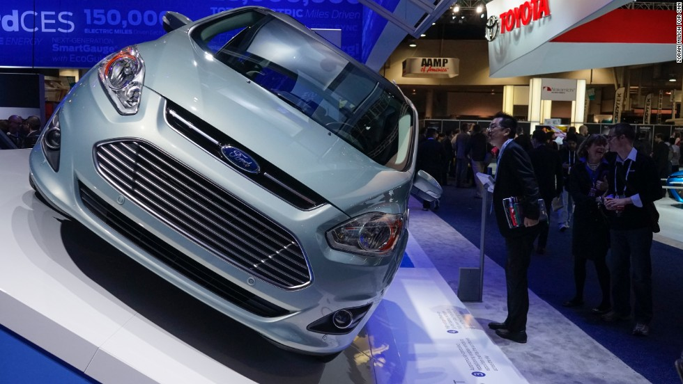 A Ford C-Max Solar Energi is a solar-powered plug-in hybrid car with solar panels on its roof.