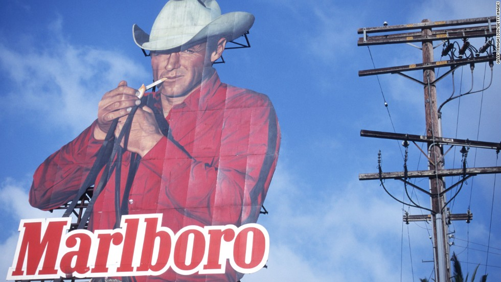 "A billboard advertises Marlboro cigarettes. The rugged ""Marlboro Man"" was a staple of the brand's marketing."