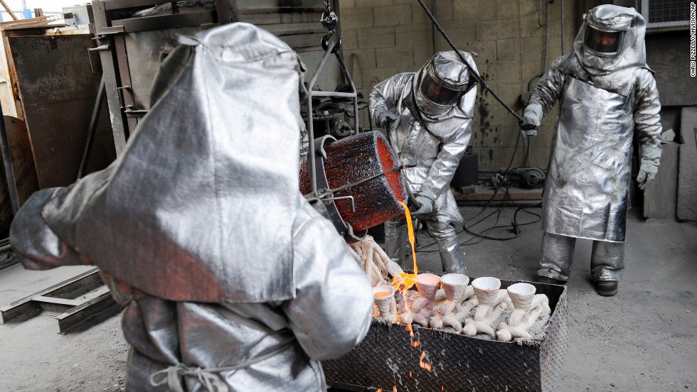 Workers from American Fine Arts Foundry cast solid bronze Screen Actors Guild Awards statuettes in Burbank, California, on Thursday, January 9. The SAG Awards will be held on January 18 in Los Angeles.