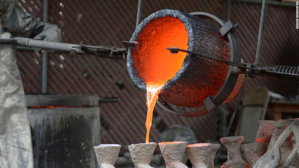 Molten bronze is poured into the casting molds.
