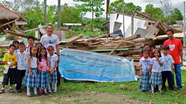 Fr. Berhabe Tujaha (left) with some of the pupils of St. Mary's elementary school, which was destroyed by Typhoon Haiyan.