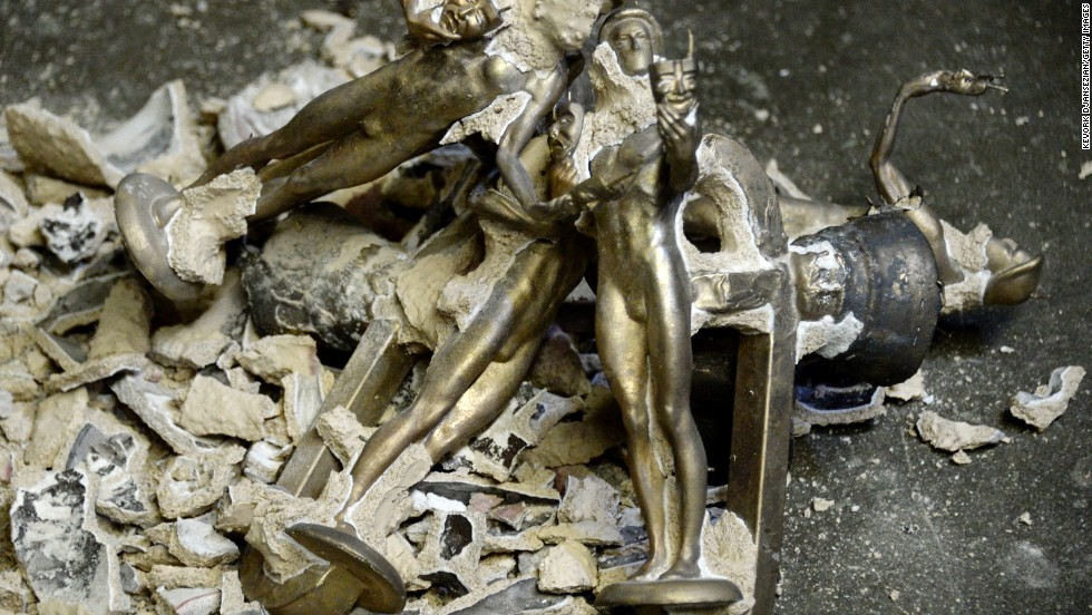 Unfinished statuettes are piled up after the plaster mold surrounding them was broken.