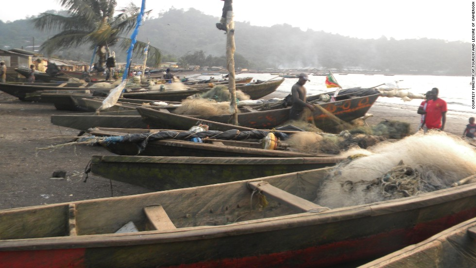 Limbe's black sand beaches are popular with tourists, and are home to sun seekers and busy local fishermen.