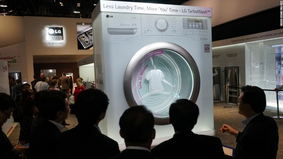 An oversized LG TurboWash washer draws the attention of convention goers.