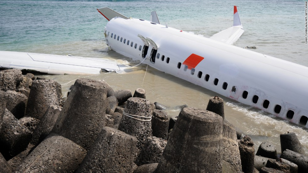Indonesia's Lion Air received two stars. Here one of the carrier's Boeing 737s lies partially submerged in the water after it crashed while attempting landing at Bali's Denpasar International Airport in April 2013.