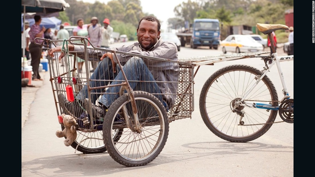"""It's because of this bicycle that I am able to make money, so if you are going to give me more, I want it. I am a Mosotho and I hustle with this wagon. There are no jobs so I have made this my job. I take tourists' luggage inside the wagon and it helps me to make a living."""