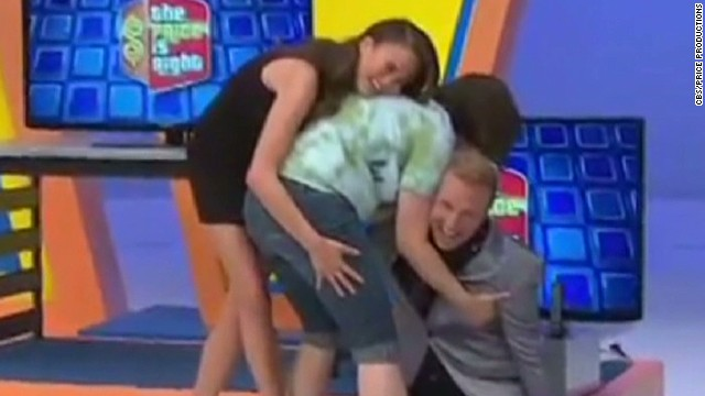 woman falls into price is right announcer newday _00002214.jpg