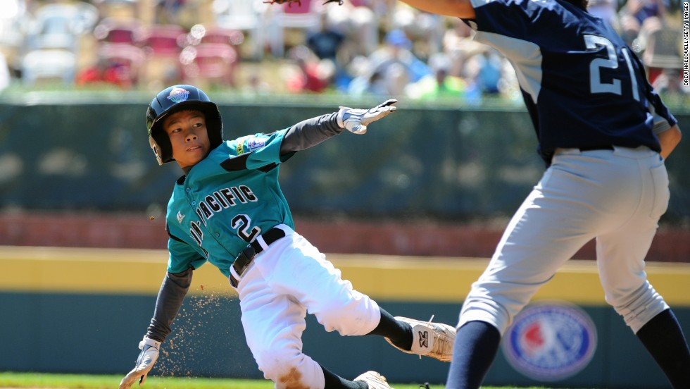 Since the first Little League World Series in 1947, Taiwan has won more championships (17) than any country, nearly double that of runner-up Japan. In this snap, young Chien-Lung Lan of the Chinese Taipei Little League slides into home base.