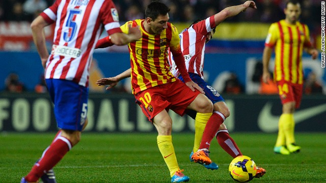 Lionel Messi tangles with former teammate David Villa during the 0-0 draw at the Vicente Calderon Stadium on Saturday.