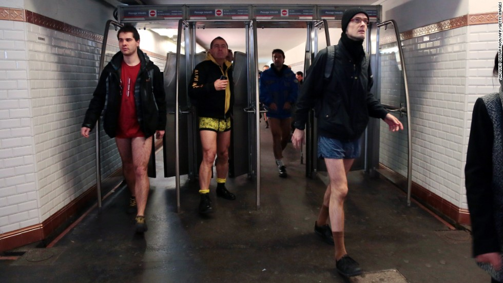 Pantsless patrons walk through a subway station in Paris.