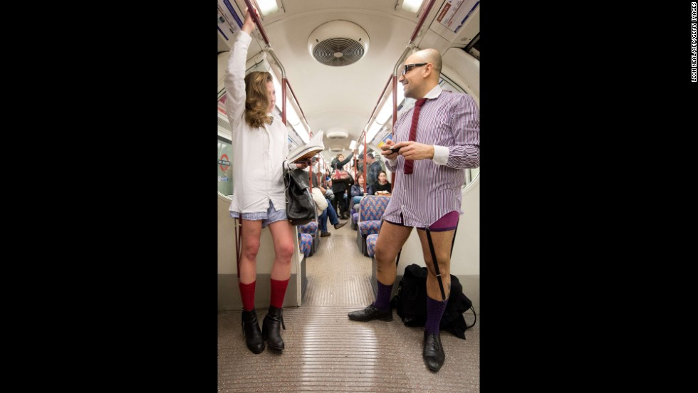 Pantsless passengers travel on a London Underground train.