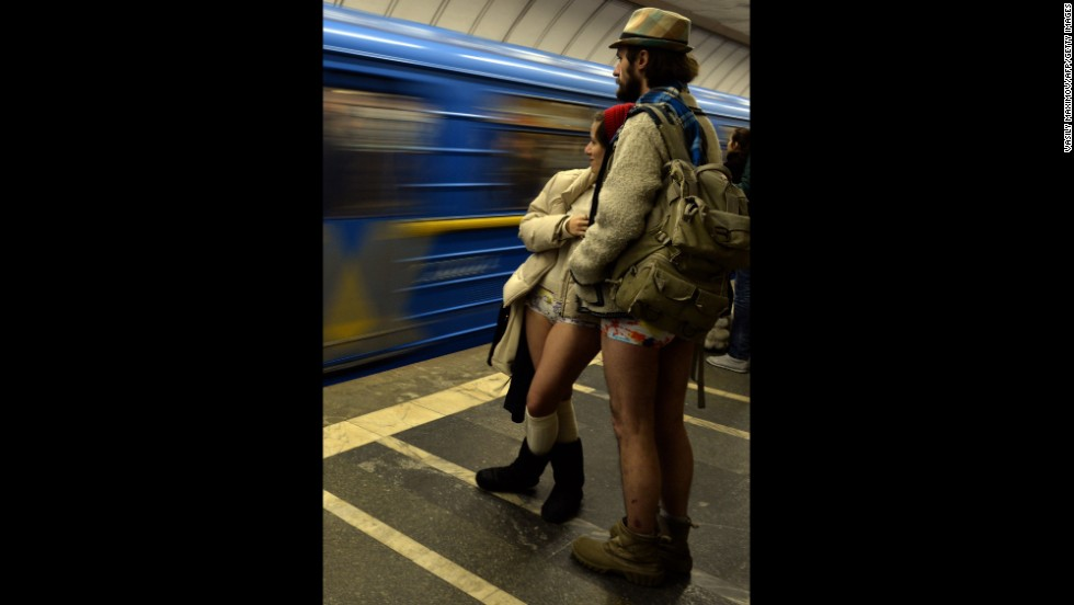 A couple in their underwear wait for a train at a Kiev, Ukraine, subway station.