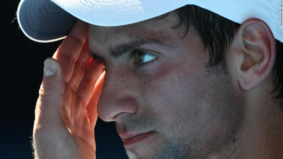 Novak Djokovic contemplates his fate ahead of his retirement with heat exhaustion in a quarterfinal match against Andy Roddick at the Australian Open in 2009.