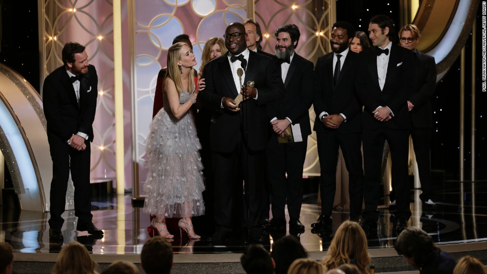 "Director Steve McQueen and the cast of the film ""12 Years a Slave"" accept the award for best drama."