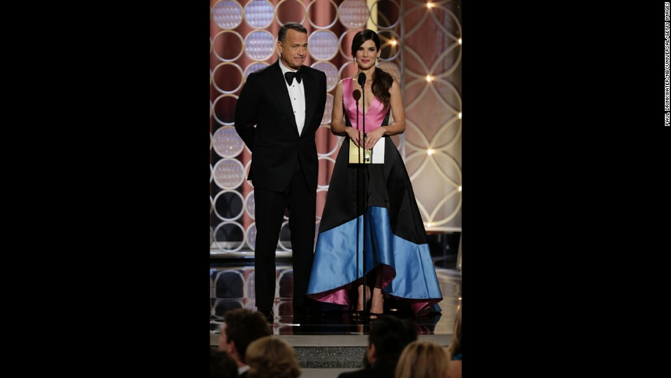 "Tom Hanks and Sandra Bullock present the award for best supporting actress in a motion picture. Jennifer Lawrence won for her role in the movie ""American Hustle."""