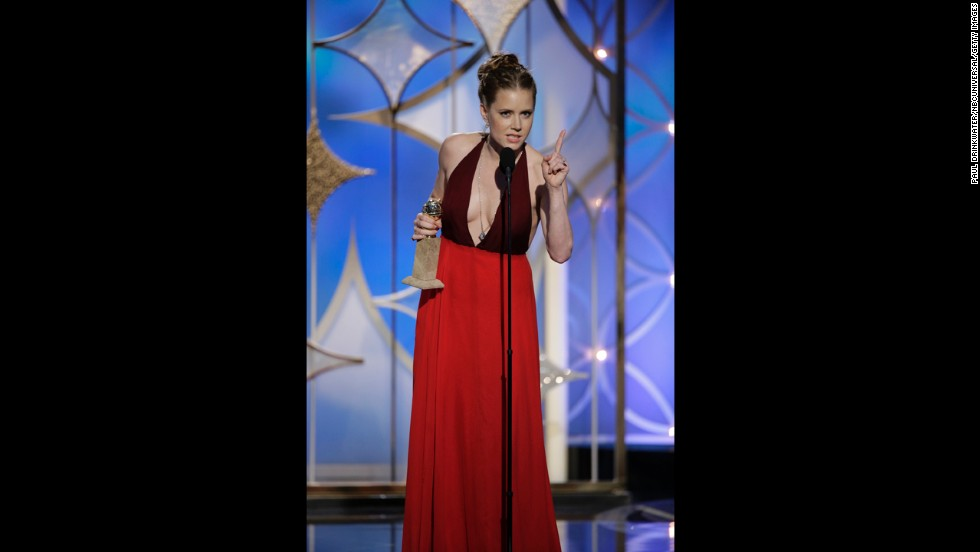 "Amy Adams, who starred in ""American Hustle,"" accepts the award for best actress in a motion picture (musical or comedy)."