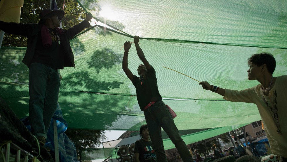 Thai anti-government protesters set up a spot with shade on a street outside the Government house in Bangkok on January 12, 2014.