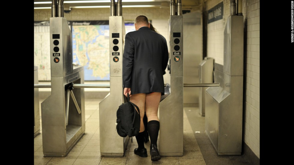 A man enters the New York subway in his underwear.