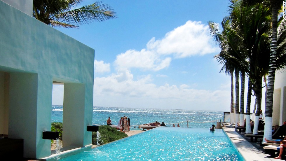 An infinity pool and a swim-up sushi bar add to the sleek feel of Oasis Tulum's recently renovated exterior.