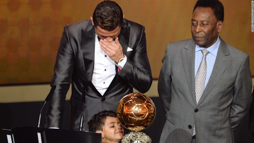 While the Portuguese star is overcome by emotion, his son Cristiano Ronaldo Jr cannot hide his glee at his father's prize.