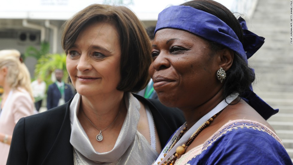 Cherie Blair poses with president of the NGO 'Fondation Espoir et Vie' Pauline Lambou Ngouanfou during the New York Forum Africa in Libreville on June 15, 2013. The forum, dedicated to the economic development of Africa, brings together nearly 700 economic policymakers.