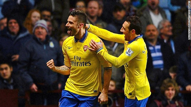 Olivier Giroud celebrates the goal that took Arsenal back to the top of the English Premier League.