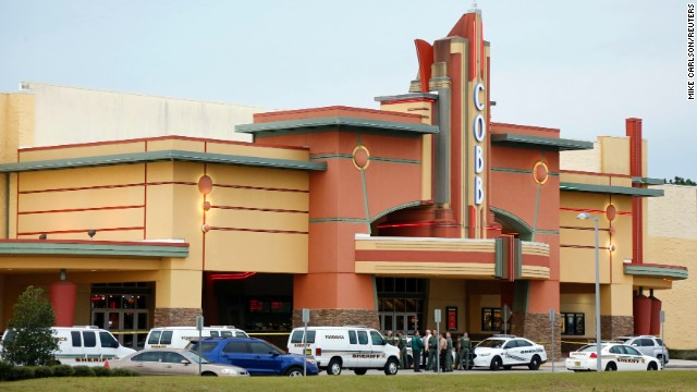 Theater shooting suspect claims defense