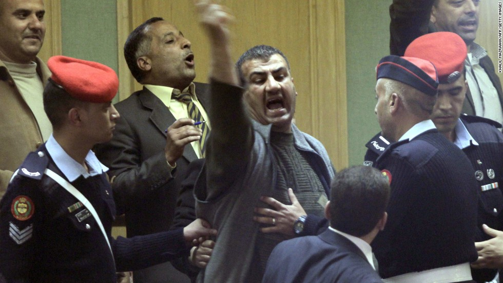 Jordanian police attempt to removes protesters opposed to Jordan's Prime Minister Abdullah Nsur after he addressed parliament in Amman, and winning a vote of confidence, on April 23, 2013.