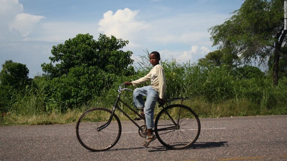 A boy in Malawi takes a more laid back approach than the Tour cyclists ...