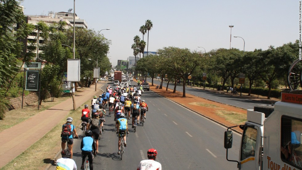 The biggest hazard for competitors? Cars. Pictured, the Tour d'Afrique convoy snakes into Kenyan capital Nairobi. (Pictured, 2013 Tour)