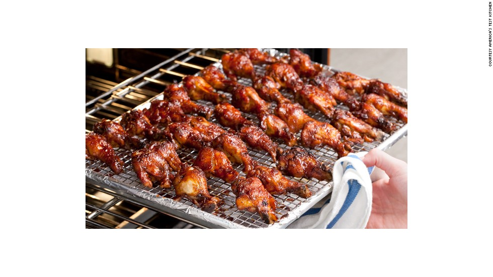 Broil, brushing twice with sauce, until wings are browned and sticky. Brush with remaining sauce and serve.