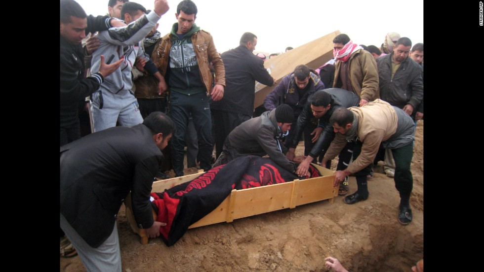 Mourners prepare to bury a man killed in a mortar attack in Falluja, Iraq, on Tuesday, January 14. Since the beginning of January, violence in the city just west of Baghdad has increased as Sunni tribesmen and members of the Islamic State of Iraq and Syria took over the city.