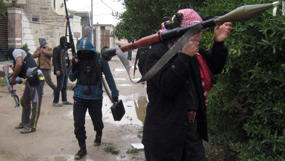 Gunmen patrol a street in Falluja on Saturday, January 11.