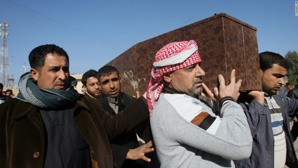 Mourners carry a coffin Wednesday, January 8; the man was killed during clashes between al Qaeda gunmen and Iraqi soldiers.