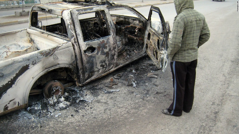 A police truck was burned in the main street of Falluja after clashes between Iraqi security forces and al Qaeda fighters on Sunday, January 5.