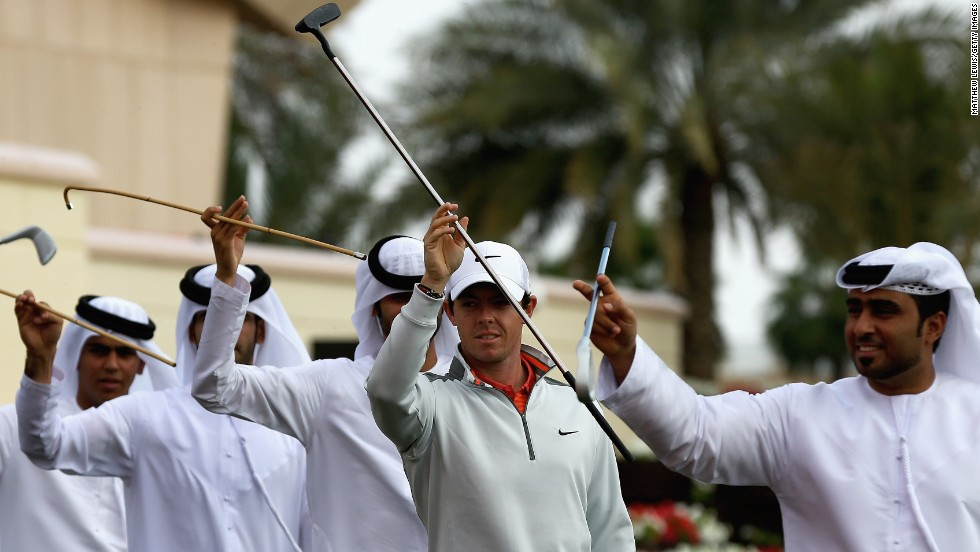 Rory McIlrory says he is feeling more relaxed ahead of the 2014 golf season and it shows as he joins in some local dancing ahead of the Abu Dhabi Golf Championship.
