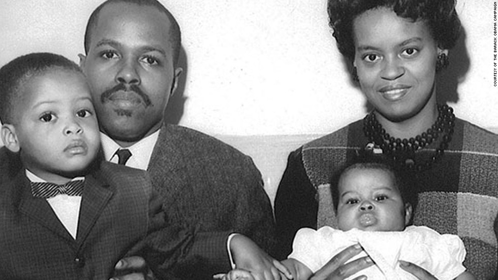 Obama was born Michelle LaVaughn Robinson in Chicago. Here, she is seen as a baby with her father, Fraser Robinson III; her mother, Marian; and her brother, Craig, in 1964.