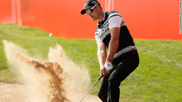 ABU DHABI, UNITED ARAB EMIRATES - JANUARY 15: Henrik Stenson of Sweden hits a bunker shot during the pro-am at the Abu Dhabi Golf Club prior to the start of the Abu Dhabi HSBC Golf Championship on January 15, 2014 in Abu Dhabi, United Arab Emirates. (Photo by Scott Halleran/Getty Images)