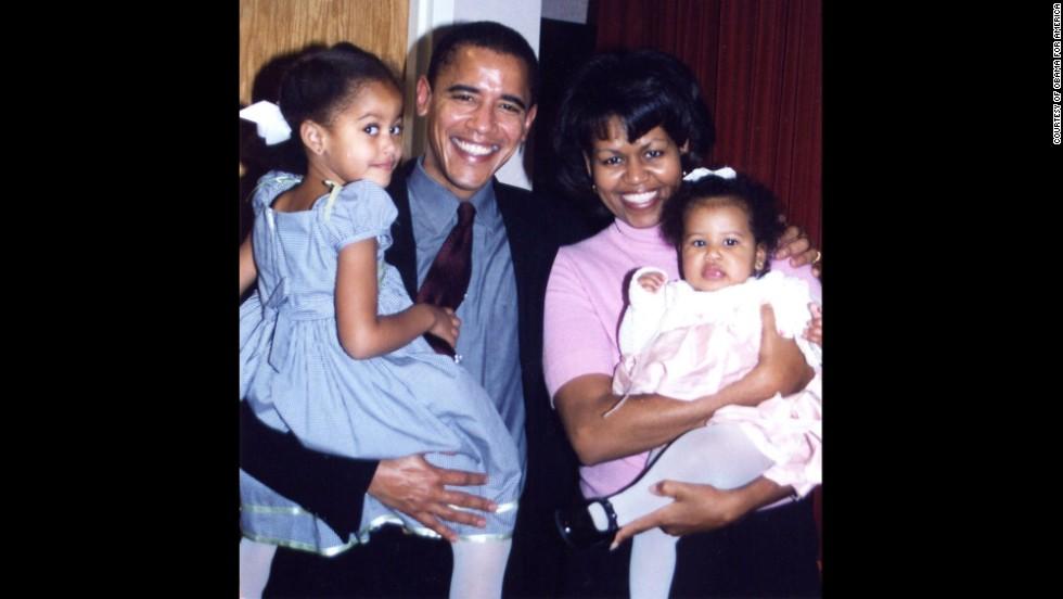 The Obamas are seen with daughters Malia and Sasha at Sasha's christening. Sasha was born on June 7, 2001.