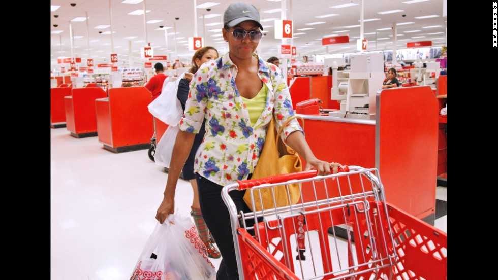 Michelle Obama exits a Target department store in Alexandria, Virginia, after doing some shopping in September 2011.